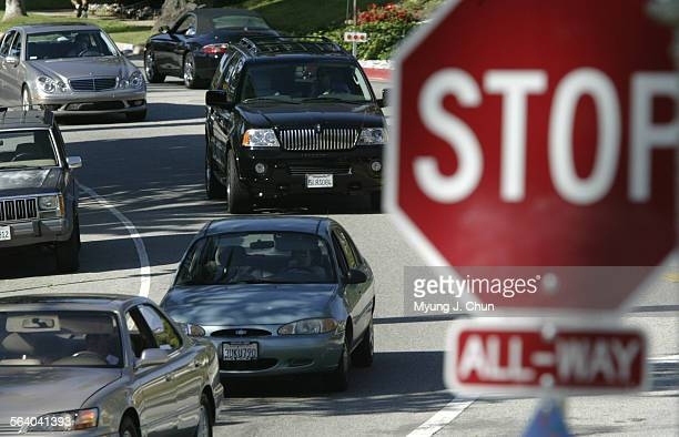 Cars line up at a stop sign on Motor Avenue and Cheviot Drive in Cheviot Hills Wednesday afternoon 5/18/2005 Measures installed recently to calm the...