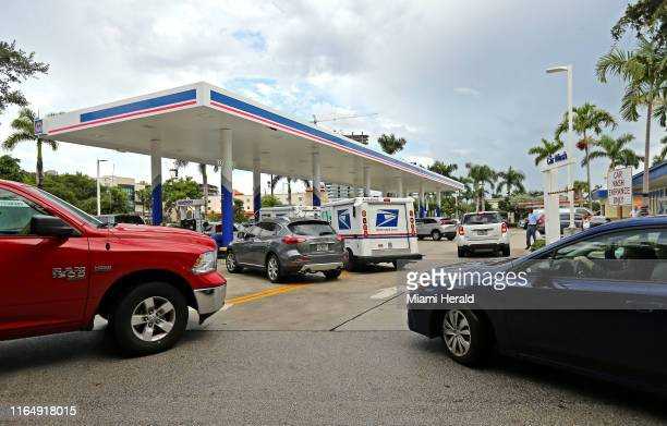 Cars line up at Marathon gas station Friday Aug 30 2019 in Aventura Fla as the state prepares for Hurricane Dorian