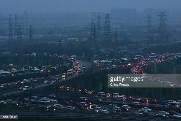 Cars line up during a traffic jam at a cloverleaf junction on September 15 2005 in Beijing China According to state media Beijing has longtime been...