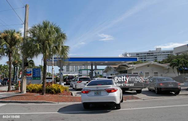 Cars line up for gasoline at a Chevron gas station in preparation for the arrival of Hurricane Irma on Wednesday Sept 6 2017 in North Miami Fla