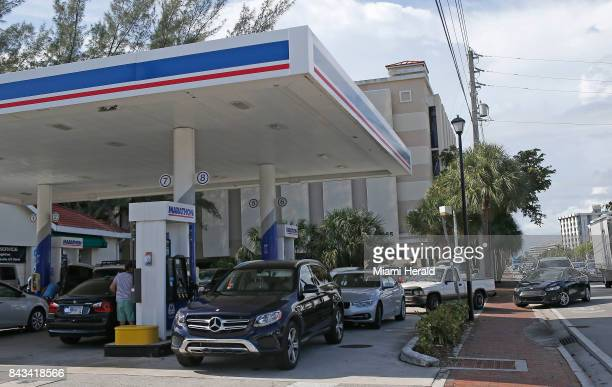 Cars line up for gasoline at a Marathon gas station in preparation for the arrival of Hurricane Irma on Wednesday Sept 6 2017 in North Miami Fla