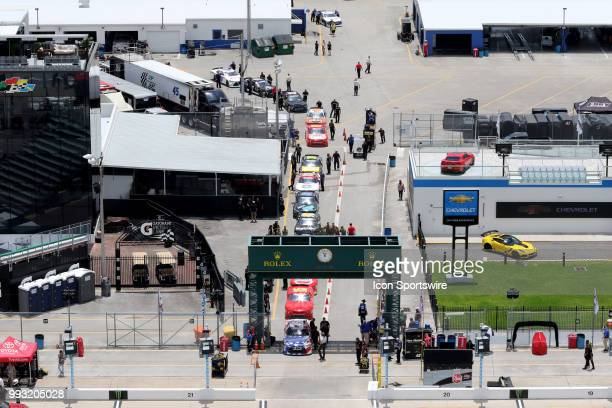 Cars line up for the rained out qualifying for the CocaCola Firecracker 250 race on July 6 at Daytona International Speedway in Daytona Beach FL