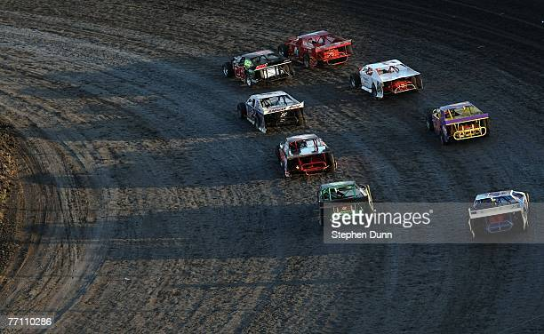Cars line up for the start of a race during the Lone Star Nationals Dirt Track