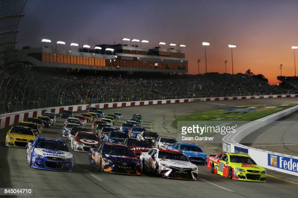 Cars line up four wide in a salute to fans prior to the Monster Energy NASCAR Cup Series Federated Auto Parts 400 at Richmond Raceway on September 9...