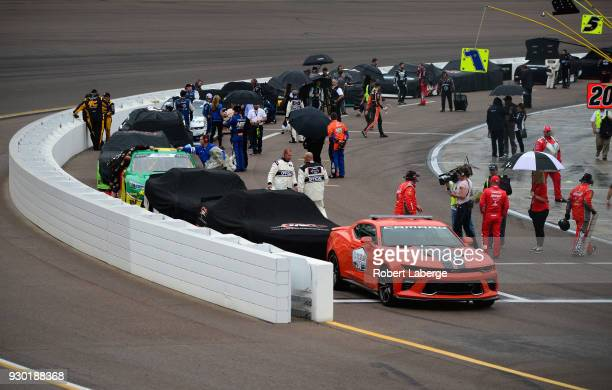Cars line up on pit road under ared flag for rain during the NASCAR Xfinity Series DC Solar 200 at ISM Raceway on March 10 2018 in Avondale Arizona