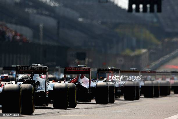 Cars line up on the grid before the Formula One Grand Prix of China at Shanghai International Circuit on April 12 2015 in Shanghai China