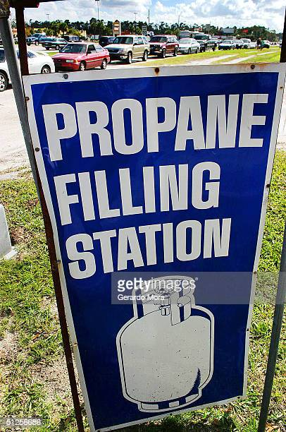 Cars line up outside of a propane filling station September 2 2004 in Orlando Florida Hurricane Frances is heading toward southeast Florida and has...