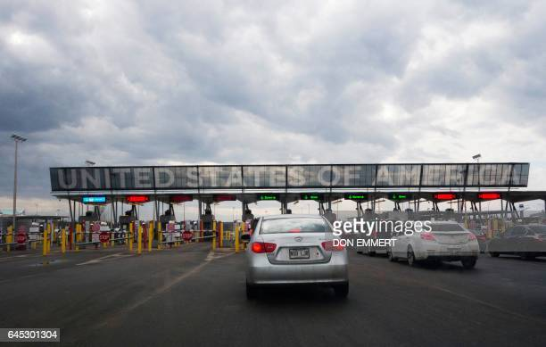 Cars line up to cross into the US at the US/Canada border on February 25 in SaintBernarddeLacolle Quebec The Royal Canadian Mounted Police said there...