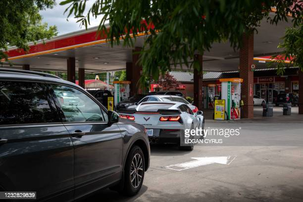 Cars line up to fill their gas tanks at a Circle K near uptown Charlotte, North Carolina on May 11, 2021 following a ransomware attack that shut down...