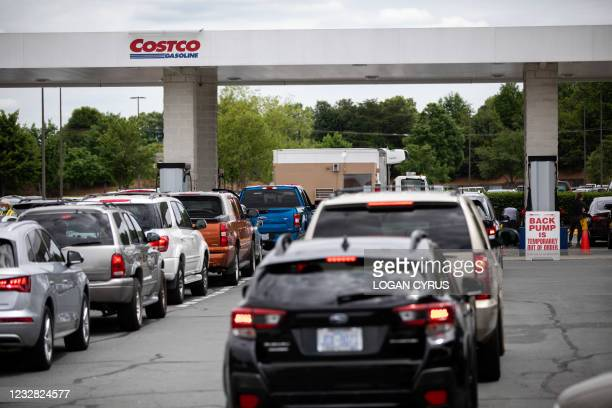 Cars line up to fill their gas tanks at a COSTCO at Tyvola Road in Charlotte, North Carolina on May 11, 2021. - Fears the shutdown of a major fuel...