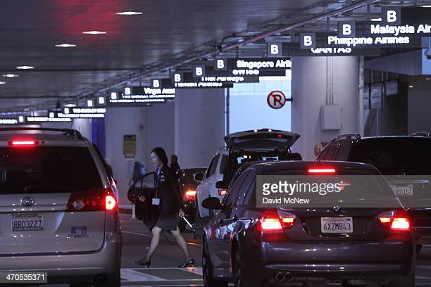 Cars line up to pick up arriving international air travelers at Tom Bradley International Terminal at Los Angeles International Airport are seen on...