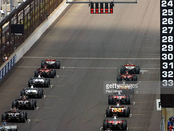 Cars line up to start the F1 Grand Prix of USA at the Indianapolis Motor Speedway on June 17, 2007 in Indianapolis, Indiana.