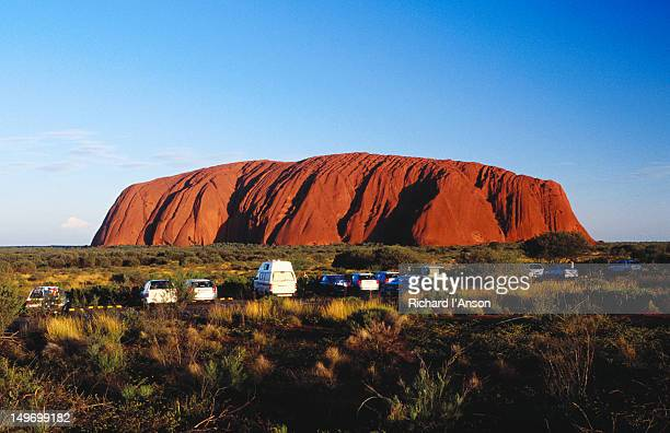 Cars lined up at viewing site, Uluru (Ayers Rock).