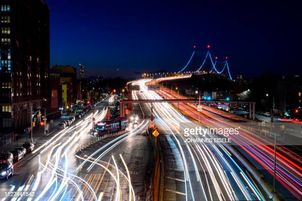 TOPSHOT Cars make their way their way over the East River on the Robert F Kennedy Bridge into Queens on February 25 2019 in New York City