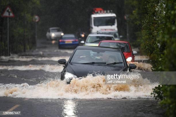 Cars make their way through flood water following torrential rain on the A760 road near to Lochwinnoch on August 2, 2020 in Lochwinnoch,Scotland. The...