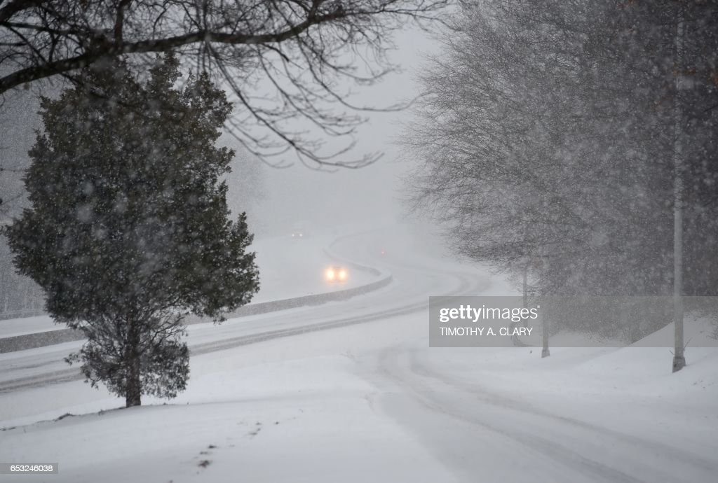 Cars make their way up a snow covered Interstate 95 near Greenwich, Connecticut March 14, 2017. Winter Storm Stella dumped snow and sleet Tuesday across the northeastern United States where thousands of flights were canceled and schools closed, but appeared less severe than initially forecast. After daybreak the National Weather Service (NWS) revised down its predicted snow accumulation, saying that the storm had moved across the coast. A. CLARY