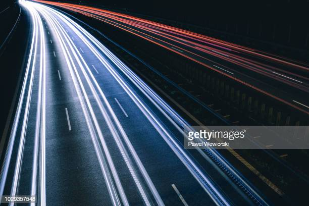 cars making light trials on busy highway - 境界線 ストックフォトと画像