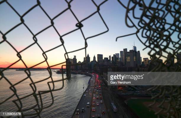 Cars move along FDR Drive as the sun sets on January 28 2019 in New York City