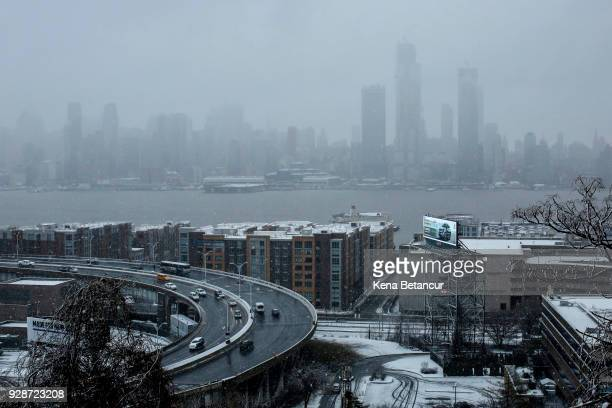Cars move along the Lincoln tunnel helix as snow falls on March 7 2018 in Union City New Jersey This is the second nor'easter to hit the area within...