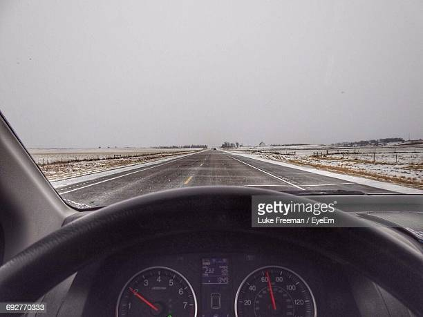 Cars Moving On Road Against Sky Seen Through Car Windshield