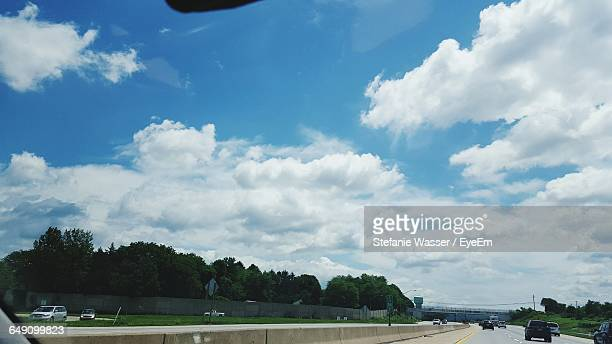 cars moving on road - wasser stock pictures, royalty-free photos & images