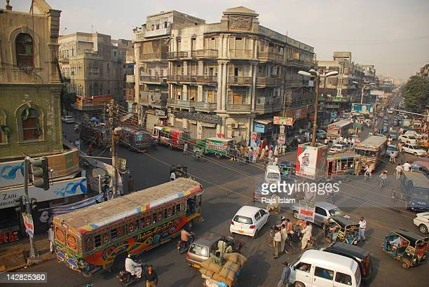cars moving on road with buildings - pakistan stock pictures, royalty-free photos & images