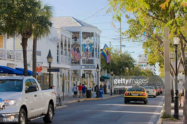 cars moving on the road, duval street, key west, florida, usa - key west stock photos and pictures