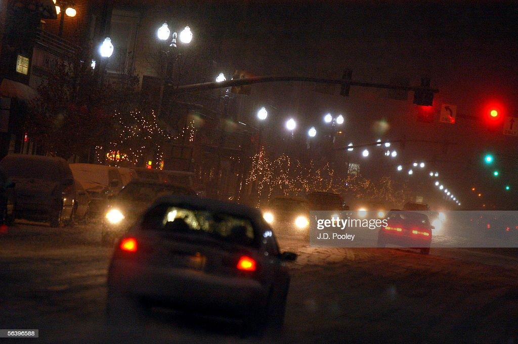 Cars Negotiate A Snow Covered Main Street December 8 In Bowling