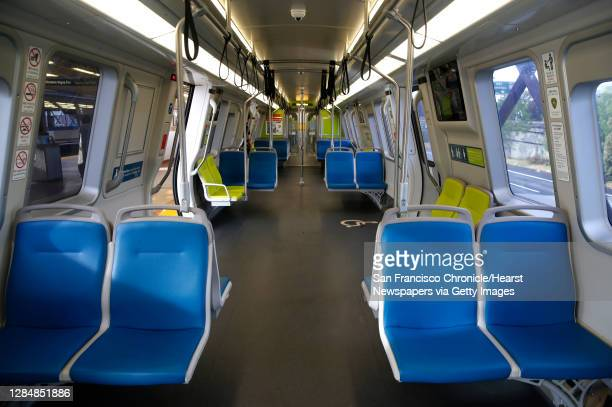 Cars of a train heading for Millbrae is devoid of commuters at the MacArthur BART station in Oakland, Calif. On Tuesday, May 12, 2020. BART is...