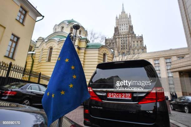 Cars of foreign ambassadors are seen parked outside the Russian Foreign Ministry headquarters in Moscow on March 21 2018 as foreign dipomatic staff...