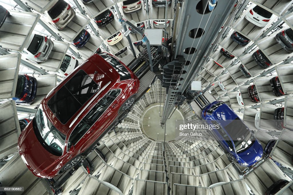 Cars of German automaker Volkswagen AG stand in one of the company's twin towers at its Autostadt customer center during the company's annual press conference to present its financial results for 2016 on March 14, 2017 in Wolfsburg, Germany. The company has mostly settled it legal disputes with authorities in the USA over its diesel emissions manipulations though it still faces a number of lawsuits and investigations in Europe where it sold a much larger number of affected cars.
