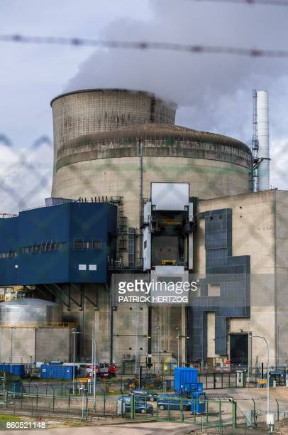 Cars of the French Gendarmerie police force are parked inside the nuclear power plant in Cattenom eastern France on October 12 2017 after Greenpeace...