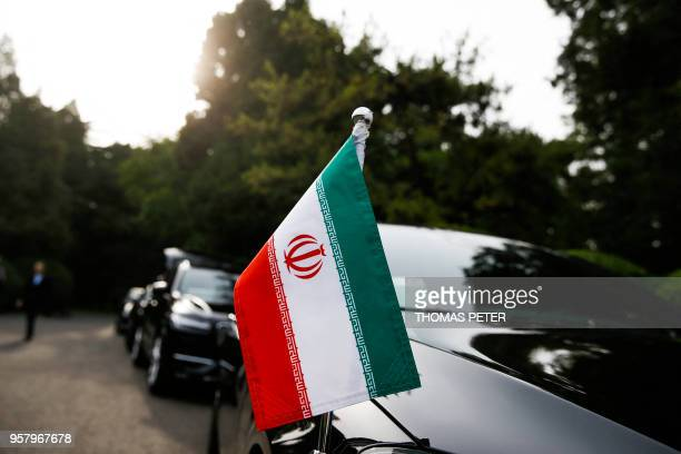 Cars of the Iranian delegation are parked outside a building of the Diaoyutai state guesthouse as Iranian Foreign Minister Mohammad Javad Zarif meets...