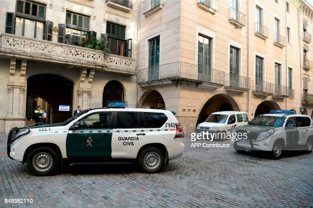 Cars of the Spanish Civil Guards are pictured in front of the city hall of Girona on September 19 2017 The Spanish Guardia Civil registered the...