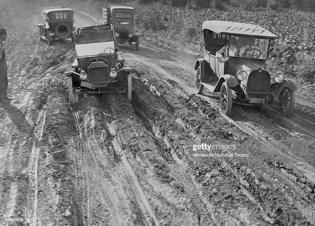 cars on rutted dirt road pictures getty images