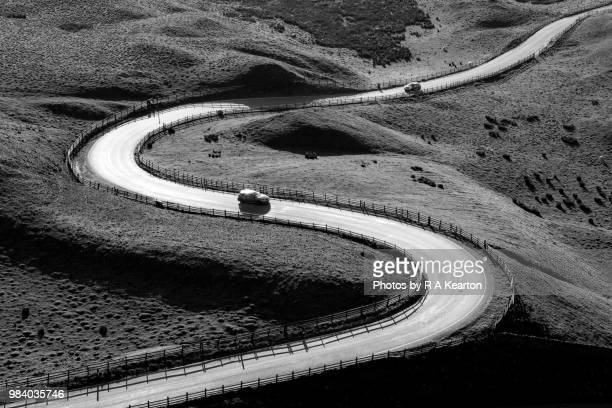 cars on a bendy road in the hills of derbyshire - high contrast stock pictures, royalty-free photos & images
