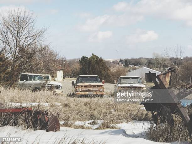 Cars On Field Against Sky During Winter