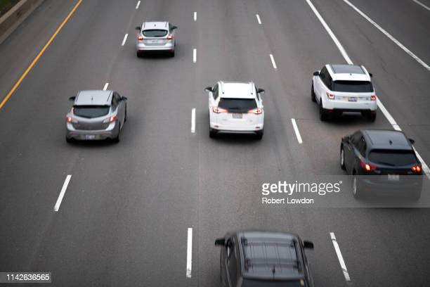 cars on highway - major road stock pictures, royalty-free photos & images