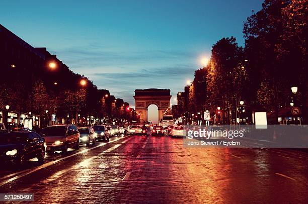 Cars On Road Against Arc De Triomphe At Night