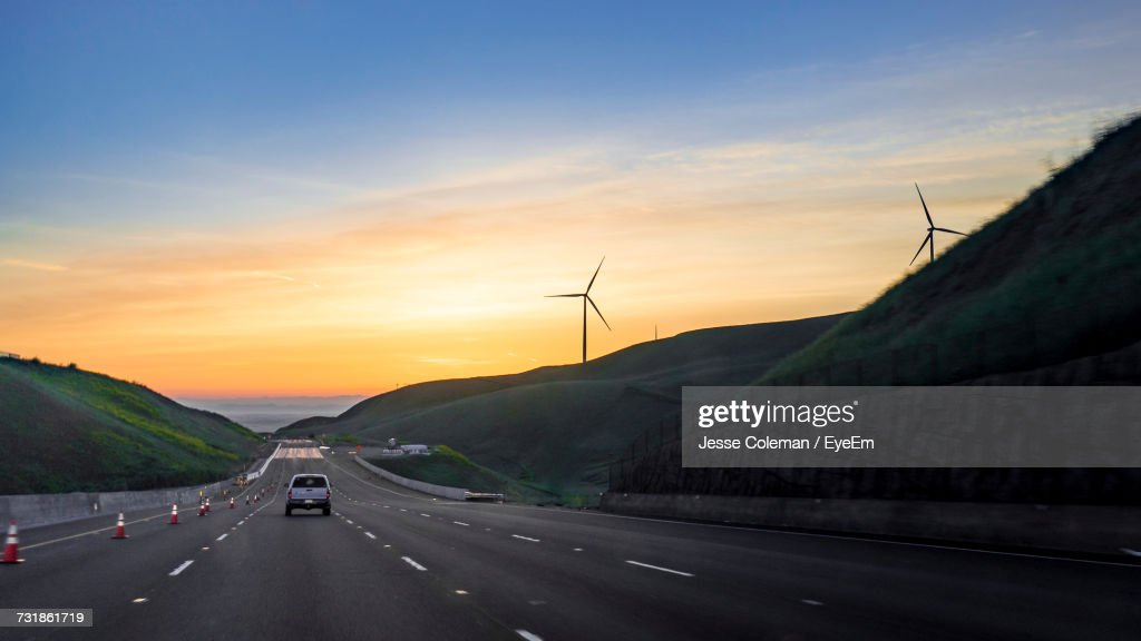 Cars On Road Against Sky During Sunset : Stock Photo