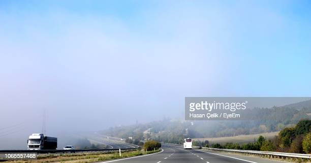 cars on road against sky - bolu city stock photos and pictures