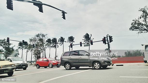Cars On Road Against Sky