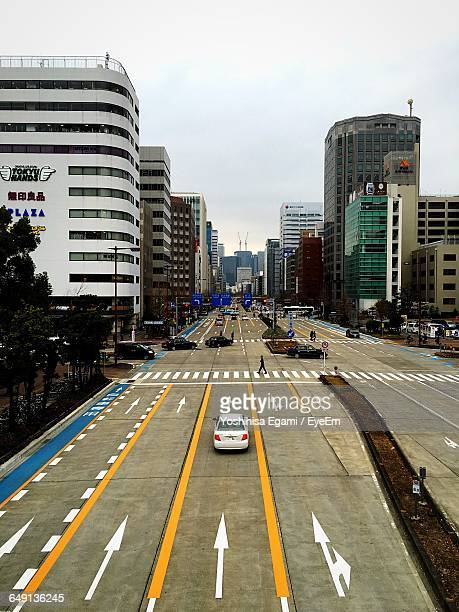 cars on road amidst buildings in city - nagoya stock pictures, royalty-free photos & images