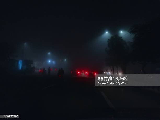cars on road at night - tail light stock pictures, royalty-free photos & images