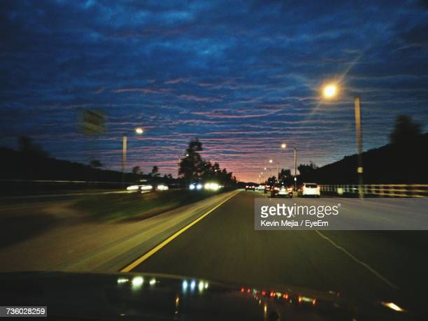 cars on road at night - santa clarita stock pictures, royalty-free photos & images