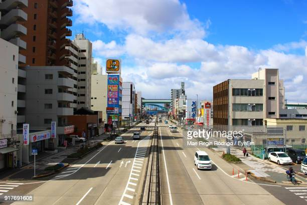cars on road in city against sky - nagoya stock pictures, royalty-free photos & images