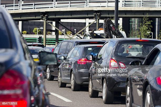 cars on road in city - traffic stock pictures, royalty-free photos & images