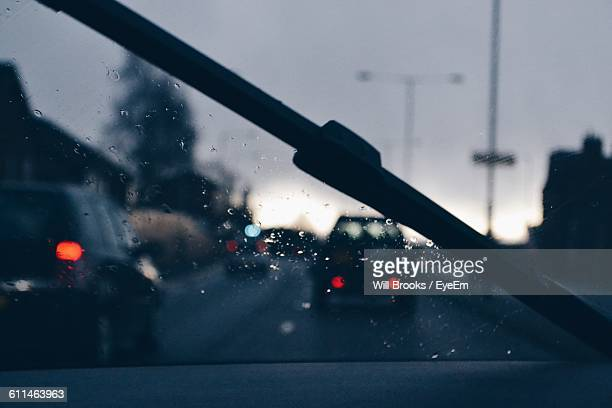 Cars On Road Seen Against Sky Seen Through Windshield
