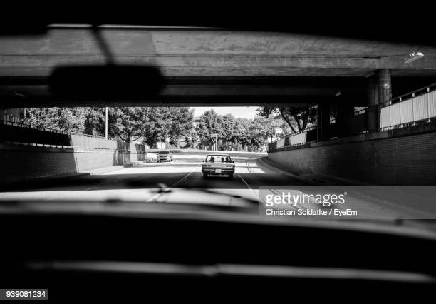 cars on road seen through windshield - christian soldatke stock pictures, royalty-free photos & images