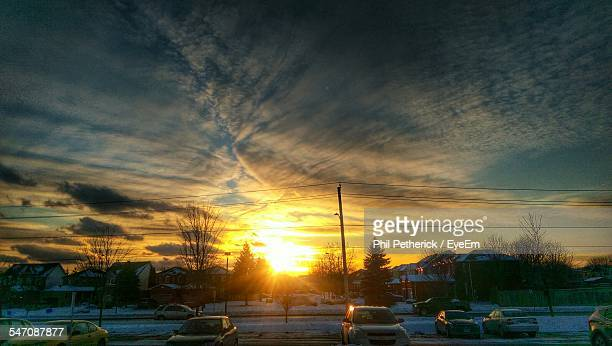 cars on snow covered road at sunset - oshawa stock photos and pictures